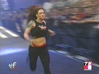 Lita comin' out to help out trish! uh oh!